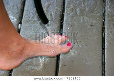 Woman Spraying Feet