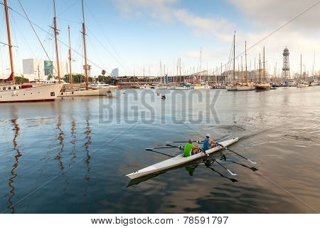 Twin Sport Racing Rowing Boat Goes In Barcelona Port Harbor