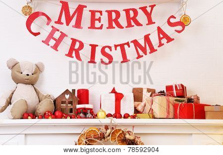Christmas decoration on mantelpiece on white wall background