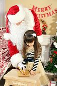 picture of letters to santa claus  - Little cute girl writing letter to Santa Claus near Christmas tree at home - JPG