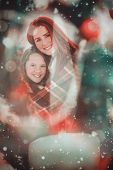 picture of blanket snow  - Festive mother and daughter wrapped in blanket against candle burning against festive background - JPG