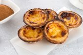 picture of pasteis  - Closeup delicious traditional asian dessert egg tarts - JPG