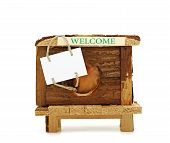 pic of groundhog day  - Wooden house hamster with a sign to advertise on a white background - JPG