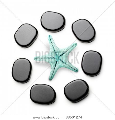 Spa stones and sea star isolated on white background.