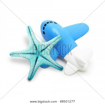 Toy airplane and sea star isolated on white background.