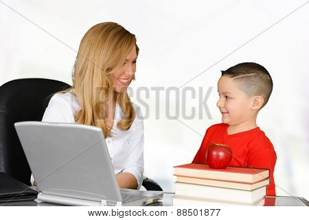 Teacher talking to her pupil about schoolwork