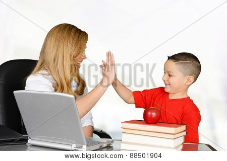 Student and teacher high five in class