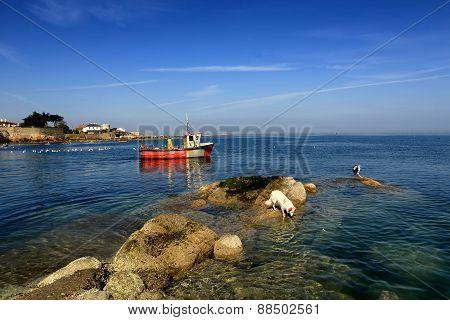 Fishing Boat Passes Rocks