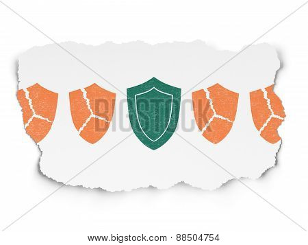 Security concept: shield icon on Torn Paper background