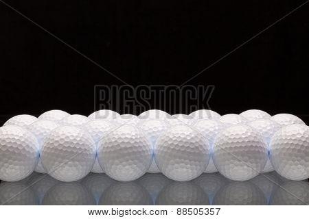 White Golf Balls On A Glass Desk