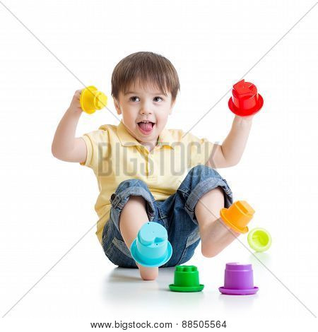 little boy playing with color toys