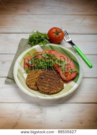 soy steak with arugula and tomatoes salad
