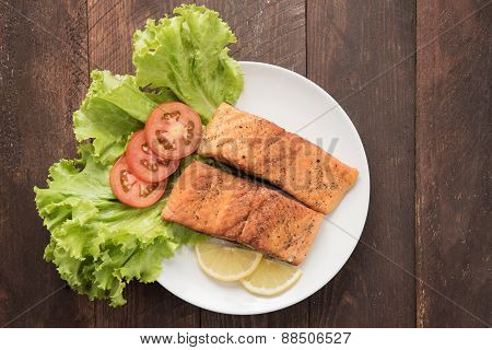 Grilled Salmon Fillet Cooked Bbq And Served With Fresh Herbs And Lemon