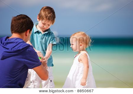 Father And Kids Making Soap Bubbles