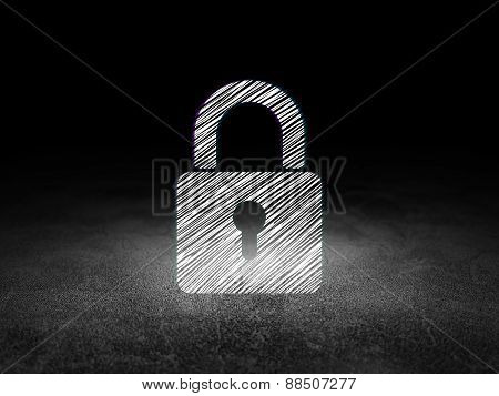 Data concept: Closed Padlock in grunge dark room