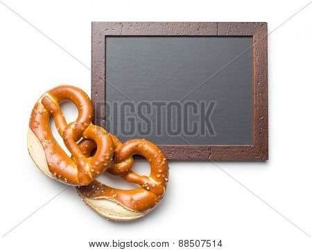 baked pretzel and chalkboard on white background