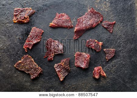 the beef jerky on old black table