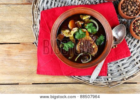 Mushroom soup on wicker mat and color napkin, top view