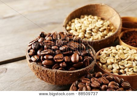 Various of coffee in small dishes on wooden table, closeup