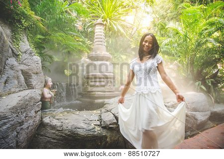 Woman Praying At Buddha Statue
