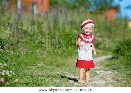 Playful Toddler Girl In Meadow