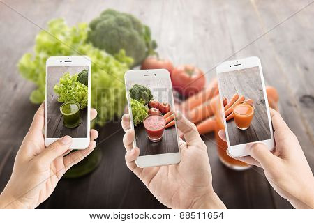 Taking Photo Of Vegetable Juices With Fresh Ingredients.