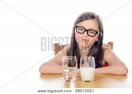 A Little Girl Has A Choice Between  Water And Milk