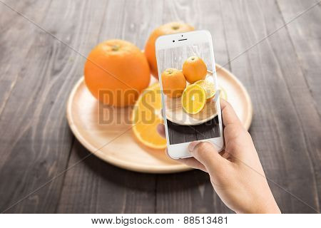 Taking Photo Of Fresh Oranges On Wooden Dish, Fresh Fruits On Wooden Background.