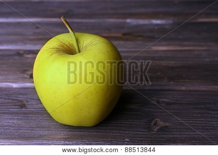 Apple on wooden background