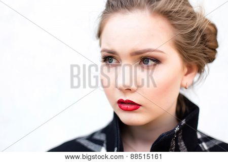 Portrait Of A Beautiful Girl In High Key Against A White Wall