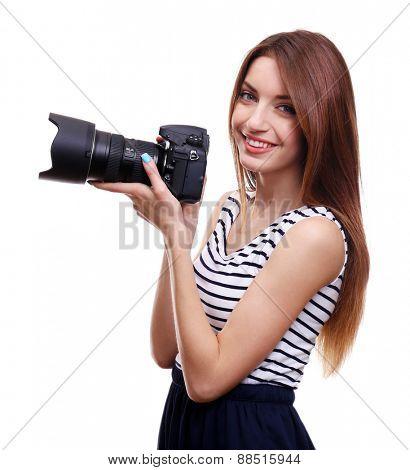 Young female photographer taking photos isolated on white