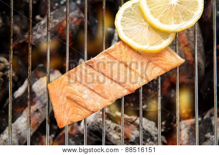 Top View Grilled Salmon With Lemon On The Flaming Grill.