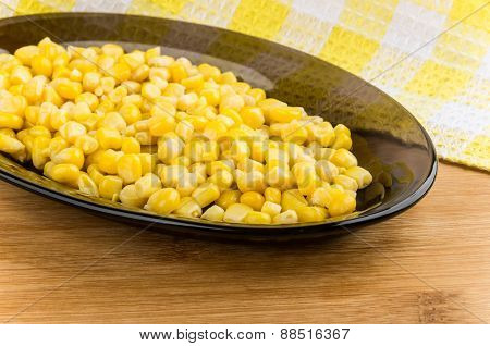 Sweet Corn In Black Glass Dish On Wooden Table