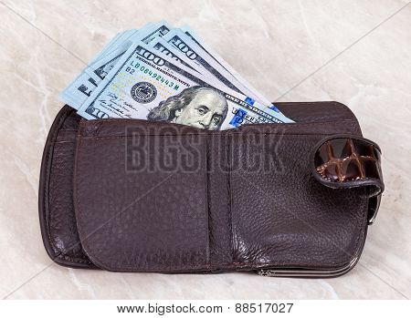 Wallet Open With A Dollar Bill Sticking Out