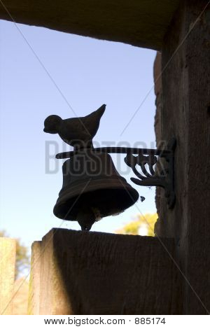 Bell On Garden Door With Metal Bird On Top