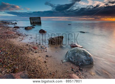 Rocky Sea Shore With Old Bunker In Sea, Long Exposure Photo