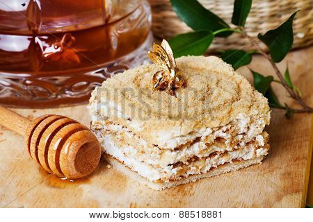 honey cake and a special spoon in still life with golden bee