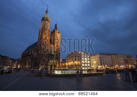 Church of St. Mary in Krakow Main Market Square during Twilight time