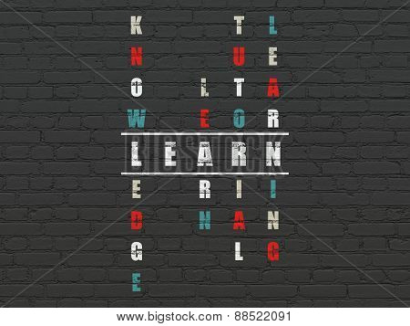 Education concept: word Learn in solving Crossword Puzzle