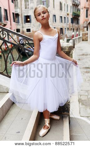 Ballet, ballerina - young and beautiful ballet dancer in Venice, Italy