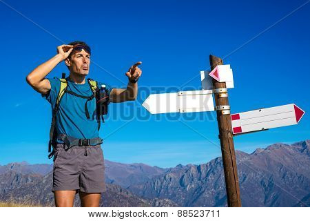 Man looking for direction at crossroad