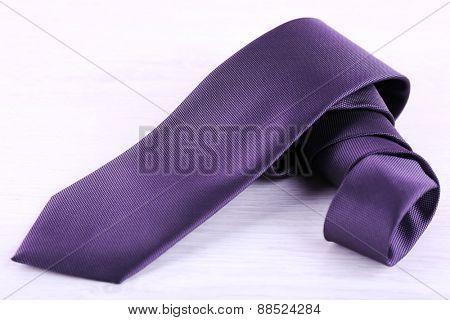 Elegance tie on wooden table background