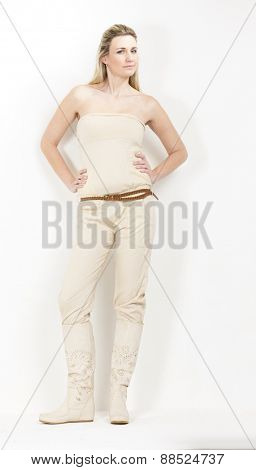 standing woman wearing summer clothes and boots