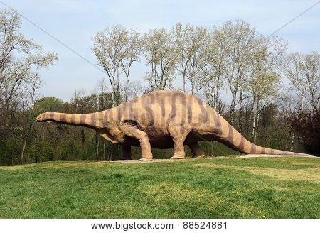Large Brontosaurus Statue Standing At Grassy Park