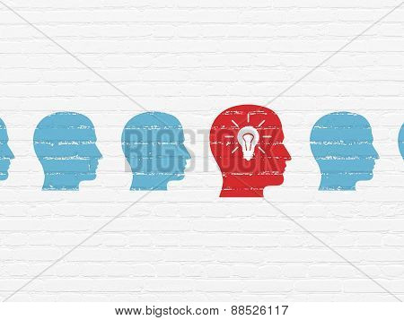 Finance concept: head with light bulb icon on wall background