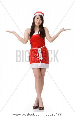 Cheerful Asian Christmas girl, full length portrait on white background.