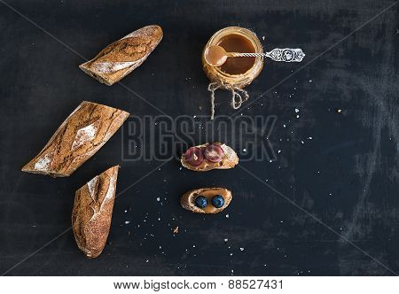 French baguette cut into pieces, sandwiches with red grapes, blueberry and salt caramel sauce on rus