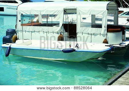 Yacht in marina in resort