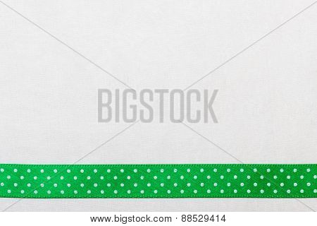 Dotted Green Ribbon Frame On White Cloth