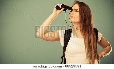 Tourist Woman Looking Through Binocular